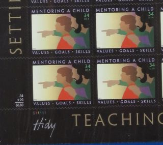 "A full sheet (20 stamps) of the postage stamp ""Mentoring a Child,"" designed by Lance Hidy. The..."